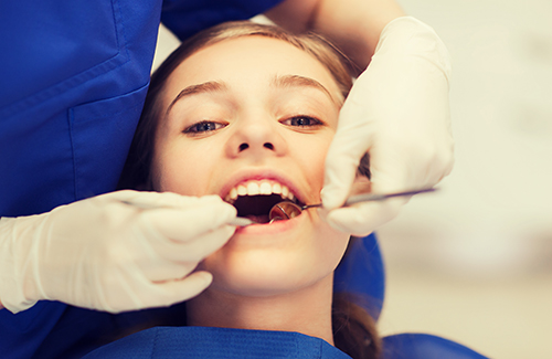 Children's Dentist in Seattle, WA teenage girl at dentist